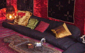 Black floor level sofa with back bolster and colourful for Floor level sofa